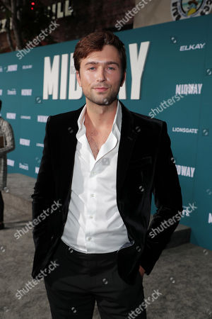 Stock Photo of Brandon Sklenar attends the Lionsgate's MIDWAY World Premiere at the Regency Village Theatre in Los Angeles, CA on November 5, 2019.