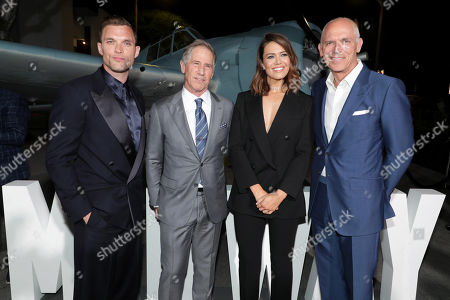 Stock Photo of Ed Skrein, Jon Feltheimer, Lionsgate Chief Executive Officer, Mandy Moore and Joe Drake, Chairman, Lionsgate Motion Picture Group, attend the Lionsgate's MIDWAY World Premiere at the Regency Village Theatre in Los Angeles, CA on November 5, 2019.
