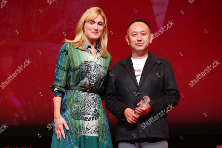 Stock Image of Julie Gayet, Shin Adachi - Shin Adachi, after winning 'Best Screenplay Award' for the film 'A Beloved Wife'