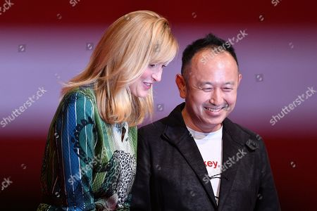 Stock Photo of Julie Gayet, Shin Adachi - Shin Adachi, after winning 'Best Screenplay Award' for the film 'A Beloved Wife'