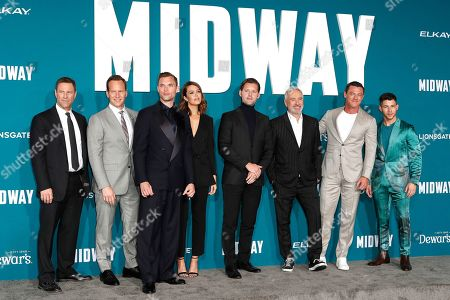 Stock Photo of 'Midway' cast members Aaron Eckhart, Patrick Wilson, Ed Skrein, Mandy Moore, Luke Kleintank, director Roland Emmerich, Luke Evans and Nick Jonas pose upon arriving at the 'Midway' movie premiere at the Regency Village Theatre in Westwood, Los Angeles, California, USA, 05 November 2019. The movie is to be released in US theaters on 08 November 2019.
