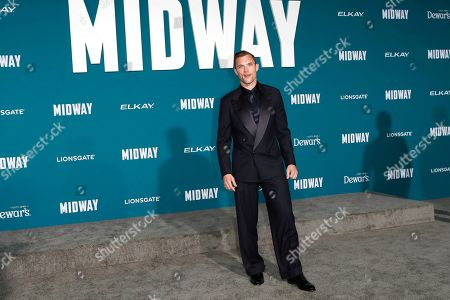 Stock Image of Ed Skrein poses upon arriving at the 'Midway' movie premiere at the Regency Village Theatre in Westwood, Los Angeles, California, USA, 05 November 2019. The movie is to be released in US theaters on 08 November 2019.