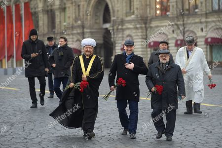 Stock Photo of Chairman of the Spiritual Administration of Muslims in the European part of the Russian Federation Rawil Gaynetdin (left) during a flower-laying ceremony at the monument to the heroes of the 1612 people's militia K. Minin and D. Pozharsky on Red Square.