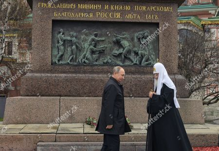 Russian President Vladimir Putin (right) and Patriarch Kirill of Moscow and all Rus' (left) during a flower-laying ceremony at the monument to the heroes of the 1612 people's militia K. Minin and D. Pozharsky on Red Square.