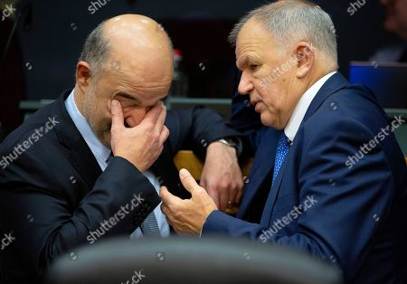 European Commissioner for Economic and Financial Affairs Pierre Moscovici, left, speaks with European Commissioner for Health and Food Safety Vytenis Andriukaitis during the weekly European Commissioners College meeting at EU headquarters in Brussels