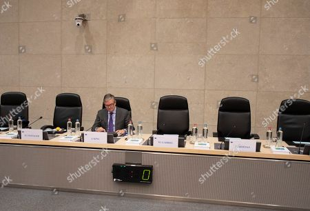 European Commissioner for Security Union Julian King waits for the start of the weekly European Commissioners College meeting at EU headquarters in Brussels
