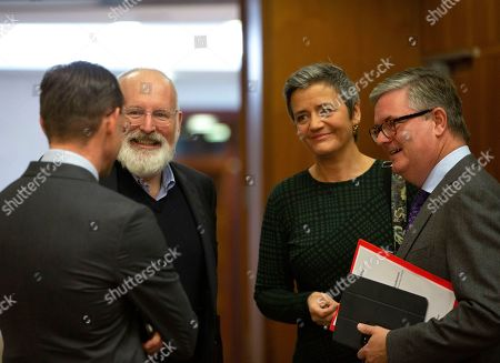 European Commission Vice-President Frans Timmermans, second left, speaks with from left, European Commissioner for Jobs Jyrki Katainen, European Commissioner for Competition Margrethe Vestager and European Commissioner for Security Union Julian King during the weekly European Commissioners College meeting at EU headquarters in Brussels