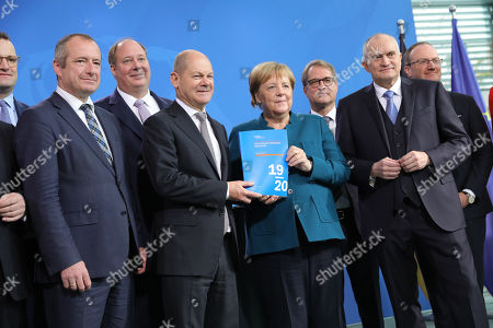 (L-R) Health Jens Spahn, Parliamentary State Secretary at the Federal Ministry for Economic Affairs and Energy, Oliver Wittke, Chancellery Minister, Helge Braun, Minister of Finance Olaf Scholz, German Chancellor Angela Merkel, Professor of Monetary Economics at Goethe University Frankfurt Volker Wieland, Chairman of the German Council of Economic Experts Christoph M. Schmidt, Director of the Walter Eucken Institute Lars P. Feld, present the Annual Report 2019/2020 on the Assessment of Macroeconomic Development by the German council of Economic Experts at the chancellery in Berlin, Germany, 06 November 2019.