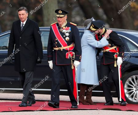 Stock Image of King Harald (C), Queen Sonja and Crown Prince Haakon of Norway welcome Slovenia's President Borut Pahor (L) to Palace Square in Oslo, Norway, 06 November 2019. Pahor is on a two-day state visit to Norway.