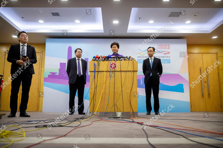 Carrie Lam, Eric Chan, Patrick Nip. Hong Kong Chief Executive Carrie Lam, center, is flanked by Eric Chan, left, director of the Chief Executive's Office, and Patrick Nip, Secretary for Constitutional and Mainland Affairs, during a press conference in Beijing, . Lam, on a visit to the mainland, met with President Xi Jinping in Shanghai on Monday in what was seen as an endorsement of her government's handling of the protests in Hong Kong. Vice Premier Han Zheng reiterated the support Wednesday after talks with Lam in Beijing