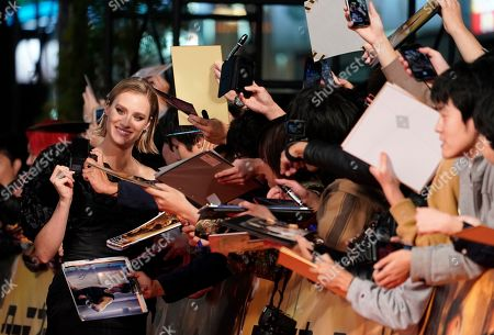 Mackenzie Davis (L) signs autographs at the Japanese premiere of 'Terminator: Dark Fate' in Tokyo, Japan, 06 November 2019. The movie will open in theaters across Japan on 08 November 2019.