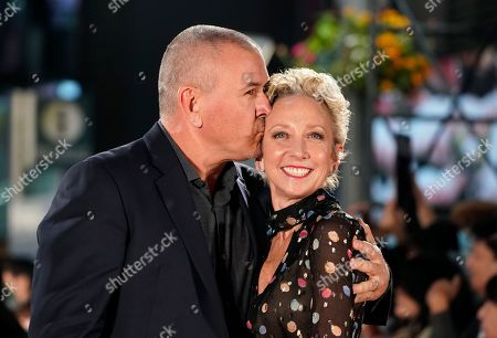 Tim Miller (L) kisses his wife Jennifer Miller during the Japanese premiere of 'Terminator: Dark Fate' in Tokyo, Japan, 06 November 2019. The movie will open in theaters across Japan on 08 November 2019.