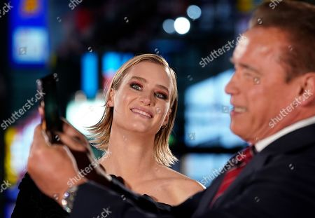 Mackenzie Davis (L) smiles as cast member Austrian-US actor Arnold Schwarzenegger takes pictures with a smartphone during the Japanese premiere of 'Terminator: Dark Fate' in Tokyo, Japan, 06 November 2019. The movie will open in theaters across Japan on 08 November 2019.