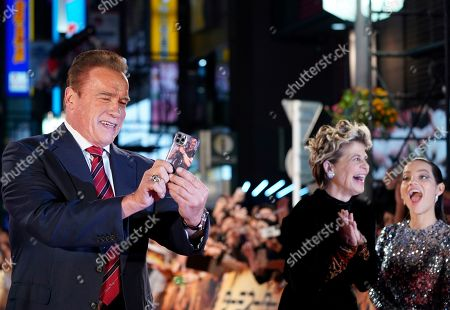Arnold Schwarzenegger takes pictures with a smartphone as US actress Linda Hamilton (C) and Colombian actress Natalia Reyes react during the Japanese premiere of 'Terminator: Dark Fate' in Tokyo, Japan, 06 November 2019. The movie will open in theaters across Japan on 08 November 2019.