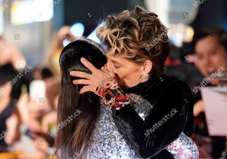 Linda Hamilton (R) kisses Colombian actress Natalia Reyes during the Japanese premiere of 'Terminator: Dark Fate' in Tokyo, Japan, 06 November 2019. The movie will open in theaters across Japan on 08 November 2019.