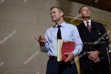 Stock Photo of Jim Jordan, Scott Perry. Rep. Jim Jordan, R-Ohio, left, and, Rep. Scott Perry, R-Pa., right, speak to reporters on Capitol Hill in Washington, near the area where the interviews for the impeachment inquiry are being held
