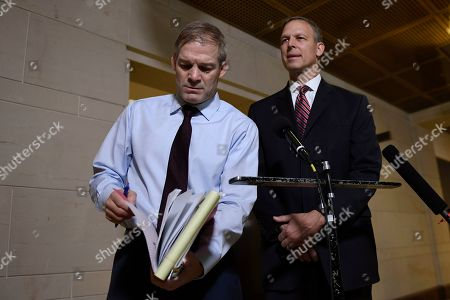 Jim Jordan, Scott Perry. Rep. Jim Jordan, R-Ohio, left, looks for something in his notes as he and, Rep. Scott Perry, R-Pa., right, speak to reporters on Capitol Hill in Washington, near the area where the interviews for the impeachment inquiry are being held
