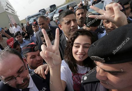 Released Jordanian detainee Heba al-Labadi arrives at the King Hussein Bridge border crossing, Jordan, on . Israeli authorities on Wednesday released Abdul Rahman Miri and Heba al-Labadi, two Jordanian citizens who'd been detained for two months and returned them to Jordan, easing a standoff that has soured relations between the countries just as they marked a chilly 25th anniversary of their historic peace deal