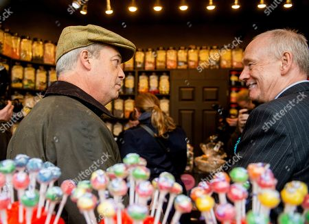 Stock Image of Brexit Party leader Nigel Farage (L) visits a sweet shop with local candidate David Walker in Whitehaven, Britain, 06 November 2019. Britons go to the polls on 12 December in a general election