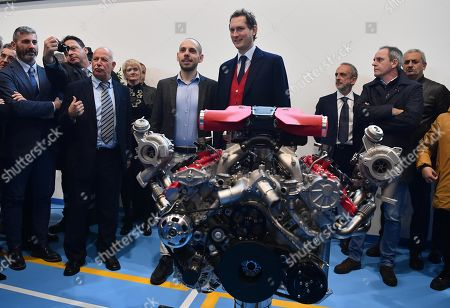 Ferrari President John Elkann unveils (L) a Ferrari's engine during the inauguration ceremony of a school named after FCA former CEO Sergio Marchionne, in Amatrice, near Rieti, central Italy, 06 November 2019. Italian-Canadian businessman Sergio Marchionne, former CEO of Fiat Chrysler Automobiles (FCA), died on 25 July 2018 at the age of 66.