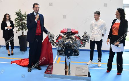 Stock Image of Ferrari President John Elkann unveils (L) a Ferrari's engine with a commemorative plaque during the inauguration ceremony of a school named after FCA former CEO Sergio Marchionne, in Amatrice, near Rieti, central Italy, 06 November 2019. Italian-Canadian businessman Sergio Marchionne, former CEO of Fiat Chrysler Automobiles (FCA), died on 25 July 2018 at the age of 66.