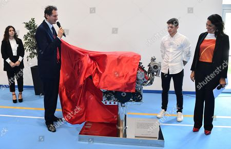 Stock Picture of Ferrari President John Elkann unveils a Ferrari's engine with a commemorative plaque during the inauguration ceremony of a school named after FCA former CEO Sergio Marchionne, in Amatrice, near Rieti, central Italy, 06 November 2019. Italian-Canadian businessman Sergio Marchionne, former CEO of Fiat Chrysler Automobiles (FCA), died on 25 July 2018 at the age of 66.