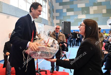 Ferrari President John Elkann receives a gift during the inauguration ceremony of a school named after FCA former CEO Sergio Marchionne, in Amatrice, near Rieti, central Italy, 06 November 2019. Italian-Canadian businessman Sergio Marchionne, former CEO of Fiat Chrysler Automobiles (FCA), died on 25 July 2018 at the age of 66.
