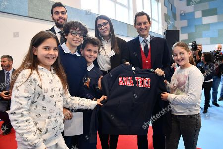 Ferrari President John Elkann (2-R) poses for a photograph with students during the inauguration ceremony of a school named after FCA former CEO Sergio Marchionne, in Amatrice, near Rieti, central Italy, 06 November 2019. Italian-Canadian businessman Sergio Marchionne, former CEO of Fiat Chrysler Automobiles (FCA), died on 25 July 2018 at the age of 66.