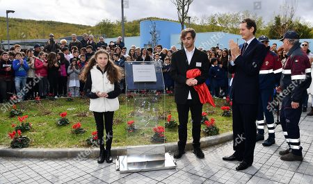 Ferrari President John Elkann unveils (R) a commemorative plaque during the inauguration ceremony of a school named after FCA former CEO Sergio Marchionne, in Amatrice, near Rieti, central Italy, 06 November 2019. Italian-Canadian businessman Sergio Marchionne, former CEO of Fiat Chrysler Automobiles (FCA), died on 25 July 2018 at the age of 66.
