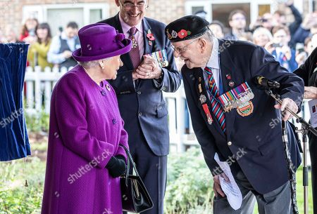 Stock Photo of Queen Elizabeth II talks with veteran Charles Boyer a resident of Appleton Lodge care facility run by the RBLI. Queen Elizabeth II was visiting the Royal British Legion Industries village in Kent on Wednesday, 6th November 2019, to celebrate the charity's centenary year. Queen Elizabeth II officially opened the new Appleton Lodge care facility and met residents.