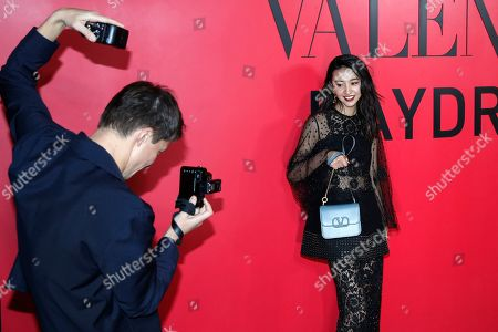 Japanese model Kimura Mitsuki, known as Koki,poses for a photographer during a cocktail party for the Valentino new flagship boutique store opening at Sanlitun Village shopping mall in Beijing