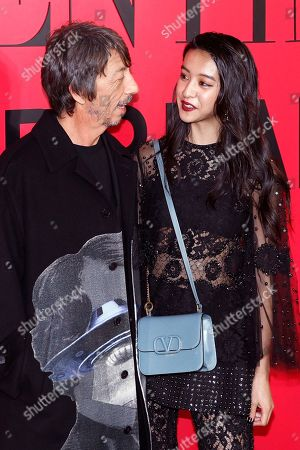Kimura Mitsuki, Pierpaolo Piccioli. Japanese model Kimura Mitsuki, known as Koki, chats with Valentino designer Pierpaolo Piccioli during a cocktail party for the Valentino new flagship boutique store opening at Sanlitun Village shopping mall in Beijing