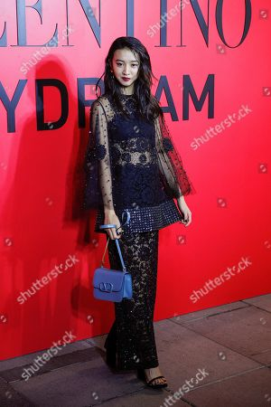 Japanese model Kimura Mitsuki, known as Koki poses for photographers during a cocktail party for the Valentino new flagship boutique store opening at Sanlitun Village shopping mall in Beijing