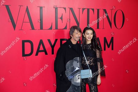 Kimura Mitsuki, Pierpaolo Piccioli. Japanese model Kimura Mitsuki, known as Koki, and Valentino designer Pierpaolo Piccioli, left, pose for photographers during a cocktail party for the Valentino new flagship boutique store opening at Sanlitun Village shopping mall in Beijing