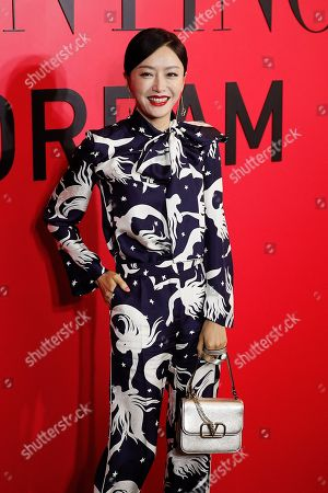 Chinese actress Qin Lan poses for photographers during a cocktail party for the Valentino new flagship boutique store opening at Sanlitun Village shopping mall in Beijing