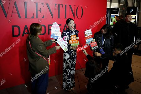 Chinese actress Qin Lan speaks to reporters during a cocktail party for the Valentino new flagship boutique store opening at Sanlitun Village shopping mall in Beijing