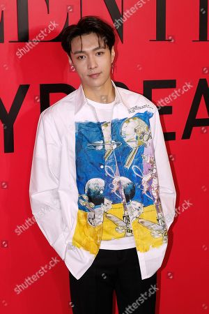 Chinese singer Zhang Yixing poses for photographers as he attends a cocktail party for the Valentino new flagship boutique store opening at Sanlitun Village shopping mall in Beijing