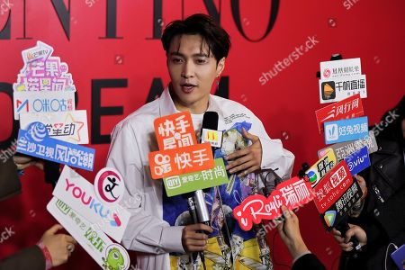 Chinese singer Zhang Yixing speaks to reporters during a cocktail party for the Valentino new flagship boutique store opening at Sanlitun Village shopping mall in Beijing