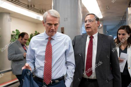 Robert Portman, John Boozman. Sen. Robert Portman, R-Ohio, left, talks with Sen. John Boozman, R-Ark., as they walk to a vote on the Senate floor at the Capitol in Washington