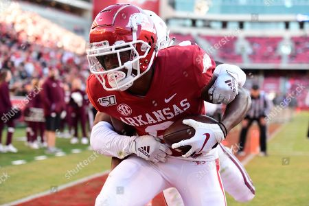 Arkansas receiver Mike Woods pulls in a touchdown catch in front of Mississippi State defender Jay Jimison the second half of an NCAA college football game, in Fayetteville, Ark