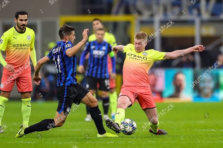 Manchester City midfielder Kevin De Bruyne (17) tussles with Atalanta midfielder Remo Freuler (11) during the Champions League match between Atalanta and Manchester City at San Siro Stadium, San Siro