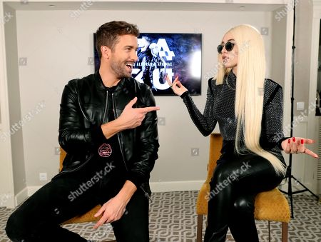 Pablo Alboran (L) and US singer Ava Max (R) pose during an interview with Spanish international news agency Efe in Madrid, Spain, 06 November 2019, on occasion of the presentation of their joint single 'Tabu'.