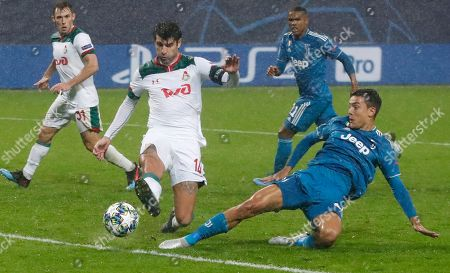 Lokomotiv's Vedran Corluka, left, fights for the ball with Juventus' Paulo Dybala during the Champions League Group D soccer match between Lokomotiv Moscow and Juventus at the Lokomotiv Stadium in Moscow, Russia