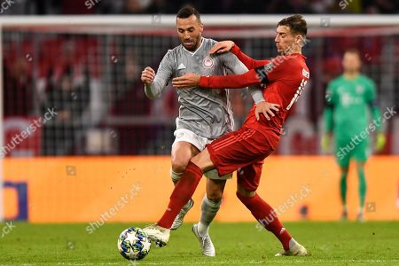 Olympiacos' Guilherme (L) in action against Bayern's Leon Goretzka (R) during the UEFA Champions League group B soccer match between Bayern Munich? and Olympiacos Piraeus at the Allianz Arena in Munich, Germany, 06 November 2019.