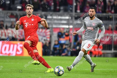 Bayern's Javi Martinez (L) and Olympiacos? Miguel Angel Guerrero (R) in action during the UEFA Champions League group B soccer match between Bayern Munich? and Olympiacos Piraeus at the Allianz Arena in Munich, Germany, 06 November 2019.