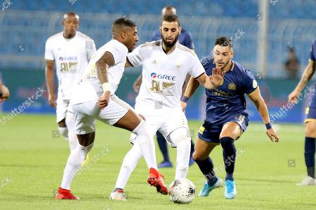 Al-Nassr player Giuliano Victor (R) in action against AL-Faisaly player Youssef El Jebli (L) during the Saudi Professional League soccer match between Al-Nassr and AL-Faisaly at Prince Faisal Bin Fahd Stadium, Al-Riyadh, Saudi Arabia, 06 November 2019.