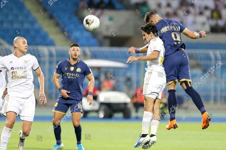 Al-Nassr player Abderazak Hamdallah (R) in action against AL-Faisaly player Khaled Al-Ghamdi (L) during the Saudi Professional League soccer match between Al-Nassr and AL-Faisaly at Prince Faisal Bin Fahd Stadium, Al-Riyadh, Saudi Arabia, 06 November 2019.