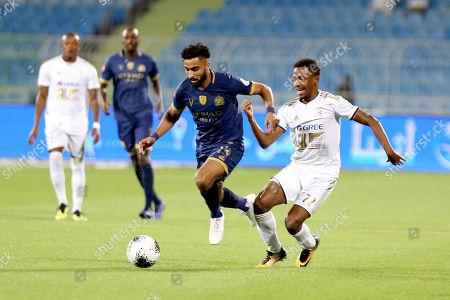 Al-Nassr player Abdulrahman Al Obaid (L) in action against AL-Faisaly player Khaled Kaabi (R) during the Saudi Professional League soccer match between Al-Nassr and AL-Faisaly at Prince Faisal Bin Fahd Stadium, Al-Riyadh, Saudi Arabia, 06 November 2019.