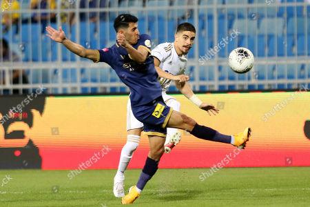 Al-Nassr player Sultan A Al-Ghanam (L) in action against AL-Faisaly player Luisinho (R) during the Saudi Professional League soccer match between Al-Nassr and AL-Faisaly at Prince Faisal Bin Fahd Stadium, Al-Riyadh, Saudi Arabia, 06 November 2019.
