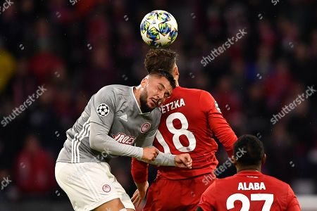 Olympiacos? Miguel Angel Guerrero (L) and Bayern's Leon Goretzka (R) in action during the UEFA Champions League group B soccer match between Bayern Munich? and Olympiacos Piraeus at the Allianz Arena in Munich, Germany, 06 November 2019.